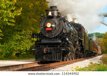 "BRECKSVILLE, OH - SEPTEMBER 29: A steam engine on the Cuyahoga Valley Scenic Railroad passes through Brecksville on September 29, 2012. The ""Steam in the Valley"" event takes place annually. - stock photo"