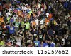BREDA, HOLLAND - OCT 7: Crowd of marathon runners relaxing just after they have finished the race during Singelloop on October 7, 2012 in Breda, the Netherlands - stock photo