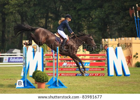 BREDA, HOLLAND - SEPT 3: Unidentified jockey on horse jumping during yearly cross country contest at Outdoor Brabant, formerly Breda Hippique on September 3, 2011 in Breda, the Netherlands