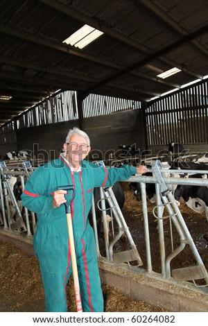 Breeder standing in barn - stock photo