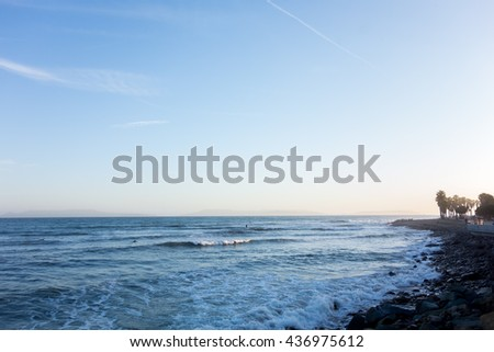 Breezy evening surf at Ventura city beach with a distant chain of Channel Islands, Ventura, CA - stock photo