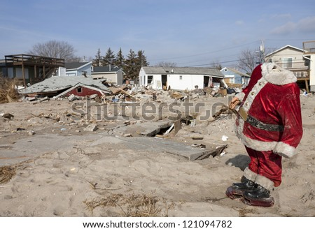 BREEZY POINT, NY - DECEMBER 3 :A scene from a post apocalyptic world unveils in front of a handicapped Santa Clause at Breezy Point, Queens, New York, U.S., on Monday, December 03, 2012. - stock photo