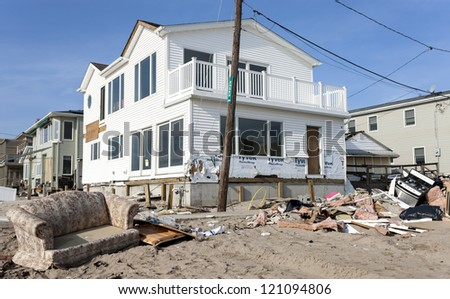 BREEZY POINT, NY - DECEMBER 3 :After more than a month from Hurricane Sandy no major reconstruction work began on Oceanside Drive at Breezy Point, New York, U.S., on Monday, December 03, 2012. - stock photo