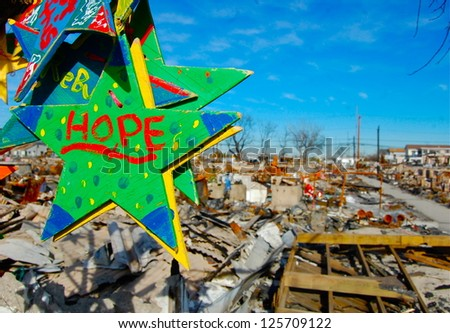 BREEZY POINT, NY - JAN 10, 2013: Numerous handmade stars hang from a burnt tree in Breezy Point, NY following a fire caused by Hurricane Sandy that destroyed 110 homes on January 10, 2013. - stock photo