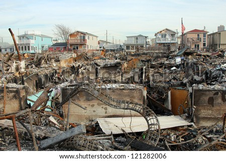 BREEZY POINT, NY - NOVEMBER 20: Burned houses in the aftermath of Hurricane Sandy on November 20, 2012 in Breezy Point, NY. More than 80 houses were destroyed in out-of-control six-alarm blaze. - stock photo