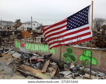 BREEZY POINT, QUEENS, NY - December 2, 2012: Video clip of wreckage and debris from fire from Hurricane Sandy. Graffiti displays shamrocks and spirit of Irish population that lives in Breezy Point. - stock photo