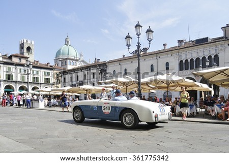 BRESCIA (BS), ITALY - MAY 14: A blue and white SIATA Daina Gran Sport Farina takes part to the 1000 Miglia classic car race on May 14, 2015 in Brescia (BS). The car was built in 1952. - stock photo