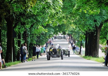 BRESCIA (BS), ITALY - MAY 14: A green Bugatti T40 Grand Sport, and a green OOF Aston Martin, take part to the 1000 Miglia classic car race on May 14, 2015 in Brescia (BS). The cars were built in 1929. - stock photo