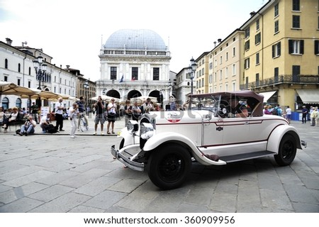 BRESCIA (BS), ITALY - MAY 14: A white Chrysler 72 takes part to the 1000 Miglia classic car race on May 14, 2015 in Brescia (BS). The car was built in 1928. - stock photo