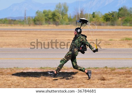 BRESCIA, ITALY - SEPTEMBER 6: italian armed forces paratrooper landing (too fast) during Brixia Air Show.  on September 6, 2009 in Brescia