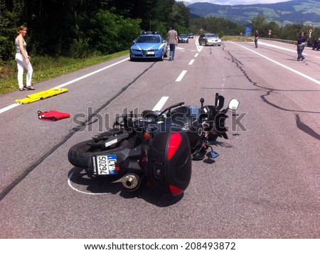 BRESSANONE BRIXEN, MAY 31, 2011: Motorcycle accident that happened on the road after car collision. Motorbike crash collision hit by car with injured motobiker in Bressanone Brixen on May 31, 2011.  - stock photo