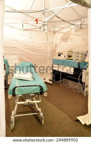 BRESSANONE, ITALY - NOVEMBER 16, 2014: Operating room camp for flood affected victims. Hospital field tent for the first AID on November 16, 2014. - stock photo