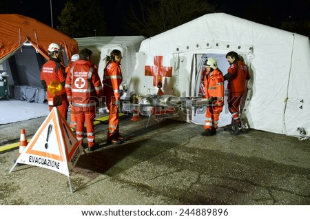 BRESSANONE, ITALY - NOVEMBER 16, 2014: Triage tent camp for flood affected victims, a mobile medical unit of red cross. Hospital field tent for the first AID on November 16, 2014. - stock photo