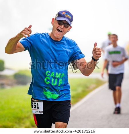 BREVARD, NC-MAY 28, 2016 - Agnus Graham,  Brevard, NC, runs in the White Squirrel Race with over 350 runners in Brevard, NC 2016.  Race is sponsored by Rotary Club of Brevard, NC - stock photo