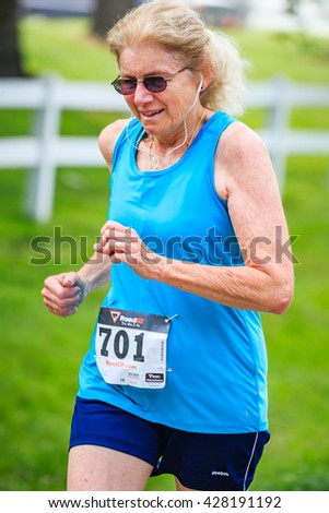 BREVARD, NC-MAY 28, 2016 -Athlete Kathleen Stahly, Asheville, NC placed 1st in 65-69 group, 10K, in the White Squirrel Race in Brevard, NC 2016.  Race is sponsored by Rotary Club of Brevard, NC - stock photo