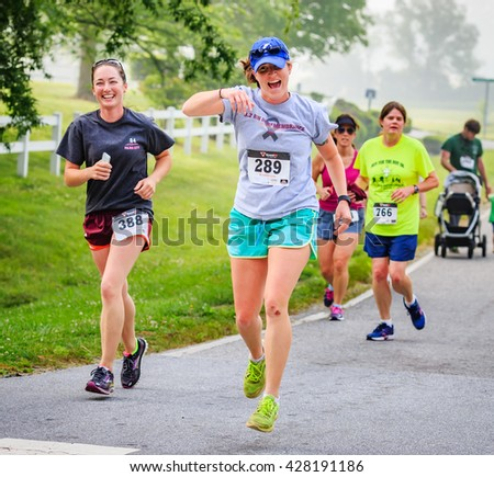 BREVARD, NC-MAY 28, 2016 -Happy ladies run in the White Squirrel Race with over 350 runners in Brevard, NC 2016.  Race is sponsored by Rotary Club of Brevard, NC - stock photo