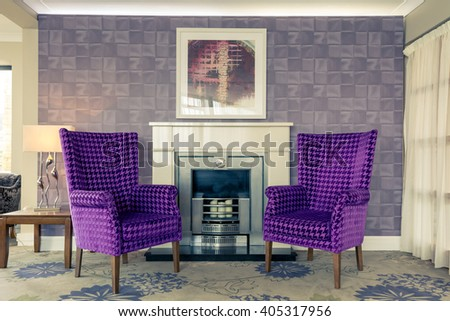 brewery waiting room living comfortable chairs purple fireplace - stock photo
