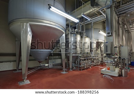 Brewing production - fermentation department, the interior of the brewery, nobody - stock photo