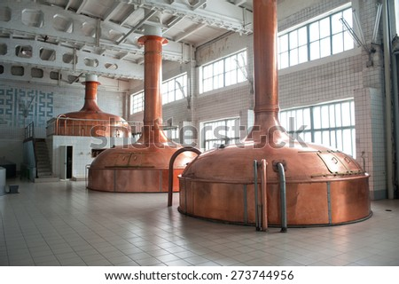 Brewing production - metal beer tanks - stock photo