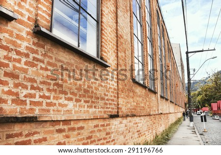 Brewing - simple architecture of brick - Iron modulated structures, perspective, large vertical windows - built in 1853 in Petropolis industry - the background with street stalls to German party - stock photo