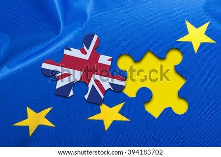 Brexit - Detail of Silky Flag of Blue European Union EU Flag Drapery With Puzzle Piece With Great Britain - stock photo