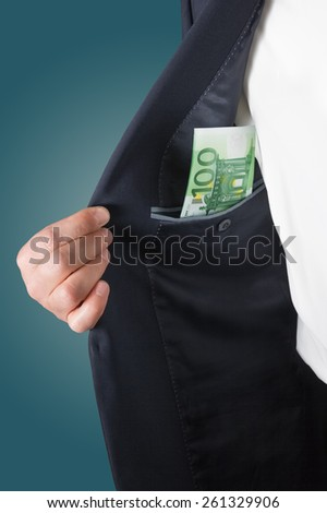 Bribe in businessmen's pocket. Euro banknotes isolated on a grey background. Man counts money euro isolated on blue background. Man hides money in his pocket. - stock photo
