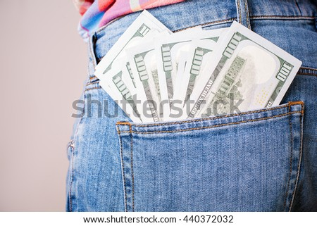 Bribery and corruption concept with dollar banknotes in jeans back pocket