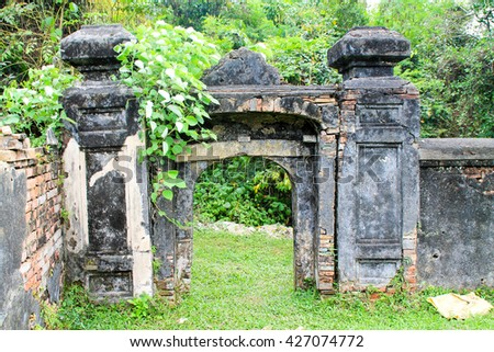 Brick and stone Archway and walkway. - stock photo