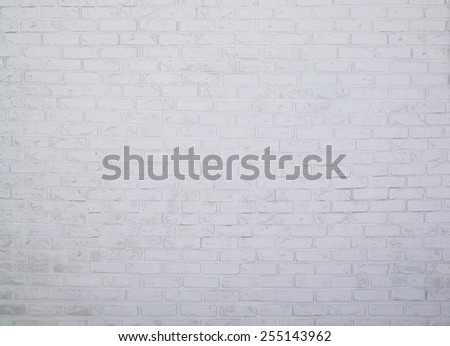 Brick Background. The texture of the brick wall of white color. Brick wall of the room is painted with white paint. Image for the background. - stock photo