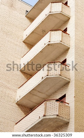 Brick balconies in modern house - stock photo