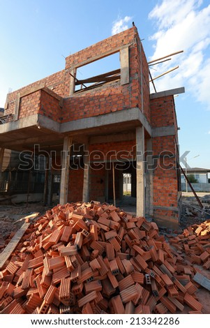 brick block in residential building construction - stock photo