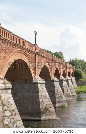 Brick bridge over Venta river in Kuldiga city, Latvia.
