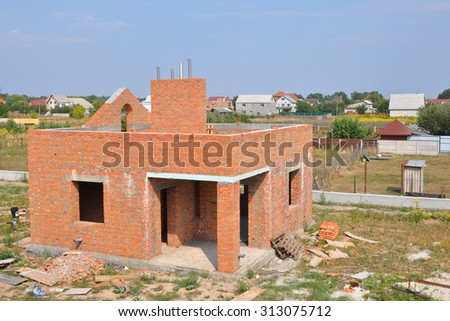 Brick building house construction with chimney - stock photo