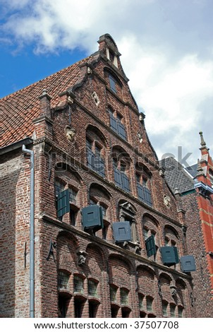 Brick building with wooden painted shutters dated 1588 in Venlo, Netherlands - stock photo