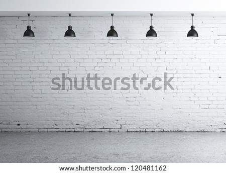 brick concrete room with five ceiling lamps
