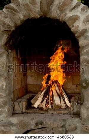Brick fireplace - stock photo