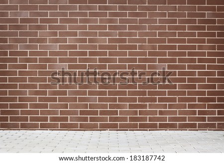 Brick grunge weathered wall background with walkway