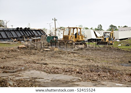 Brick High School one week after tornado damage - earthmoving equipment is shown on the grounds, along with destroyed mobile temporary classrooms. - stock photo