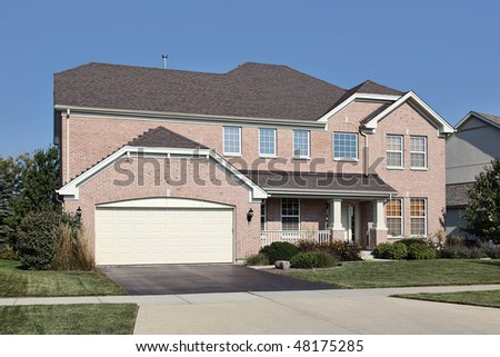 Brick home in suburbs with front porch