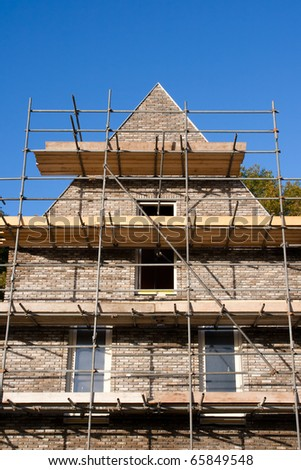 brick house construction - stock photo