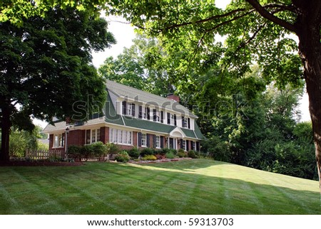 Brick House Framed with Trees - stock photo