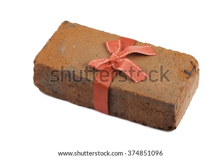 brick in a gift with bow and ribbon isolated