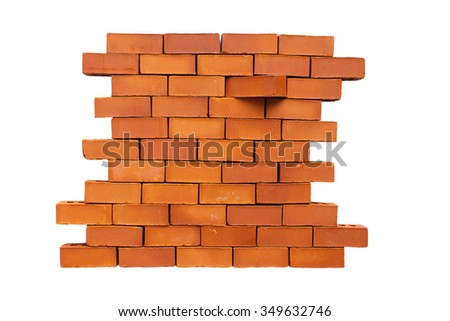 brick in the wall shifted. brick wall in the stage of destruction. one of the bricks moved from its place. Isolated on white background. concept stand out from the crowd, be different from other - stock photo