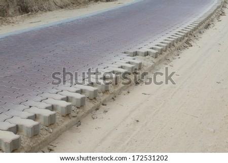 brick road is under construction - stock photo