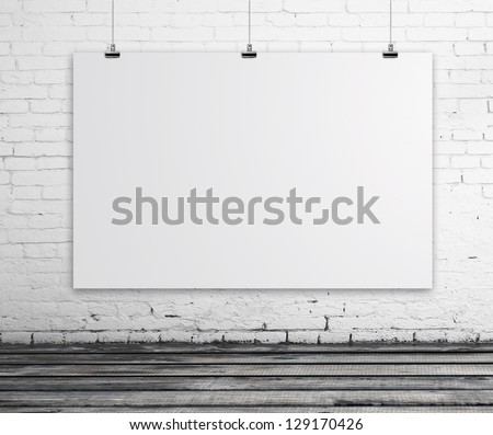 brick room with white poster - stock photo