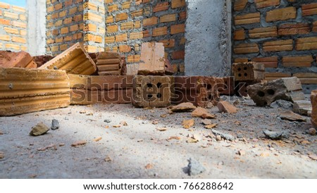 Brick stacking is not organized.group of bricks square construction materials.
