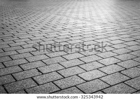 Brick stone street road. Pavement abstract texture. - stock photo