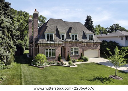 Brick suburban home with arched entry - stock photo