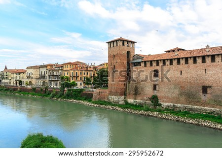 Brick tower and wall along Adige River in Verona, Italy. - stock photo