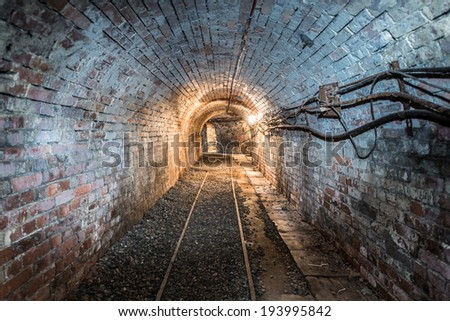 brick tunnel in mine, low voltage wires on wall